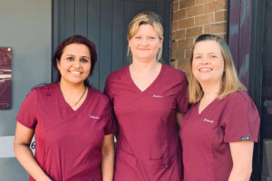 Photograph of Sahana, Malisa and Gwyneth outside the practice